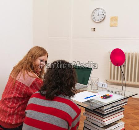 couple using laptop woman smiling