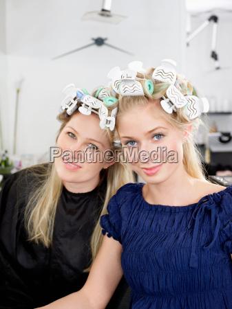 women wearing rollers in salon