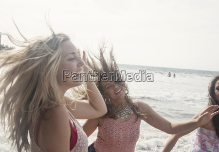 three young women fooling around on