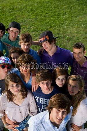 teen group portrait standing on grass