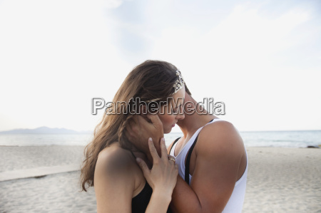 couple embracing at beach