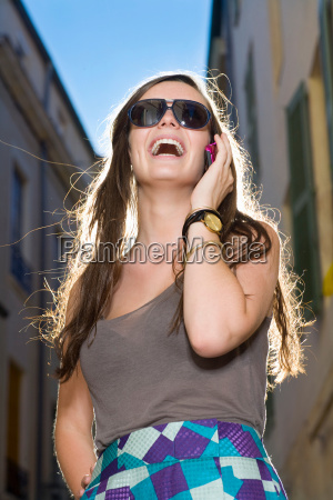 woman talks on cell phone in