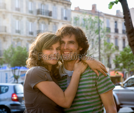 young couple standing in street