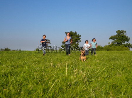 group of kids running in a