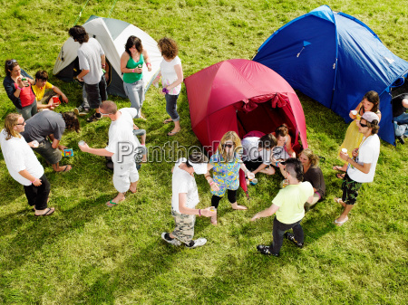 group partying outside tents