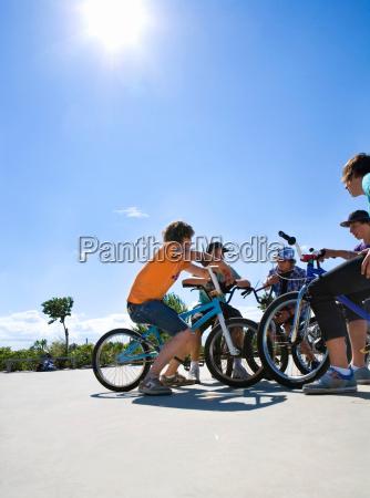 group of teenagers on bikes