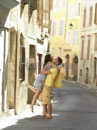 couple hugging in street