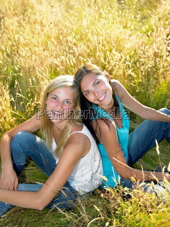 girls seated in a field