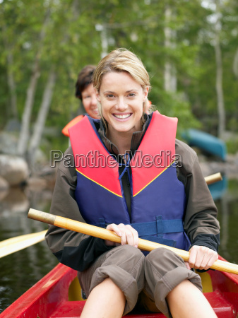 two women in a boat smiling