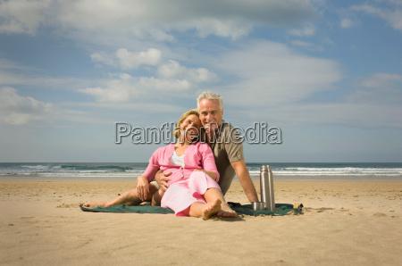 couple sat on a beach