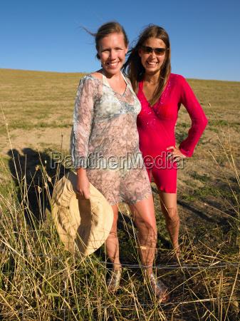 portrait of two women in field