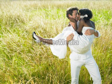 married couple in a field