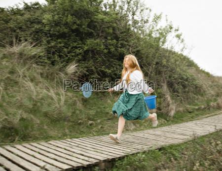girl running along decking