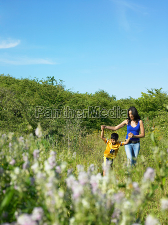 mother and son in field of