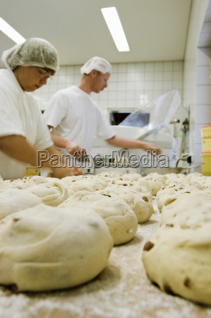 two people in a bakery with