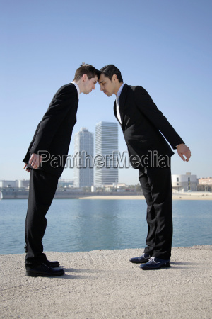 business men head to head by