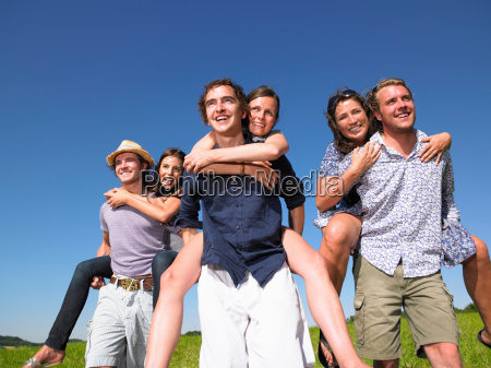 group of young people riding piggy