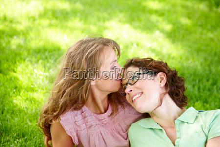 two women in loving embrace
