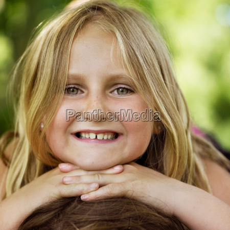 close up of girls smiling face
