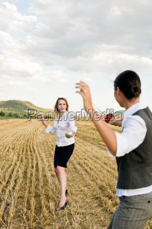 businesspeople fencing in a wheat field