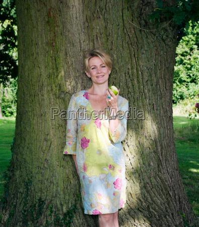 portrait of women by tree eating
