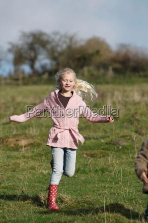 girl running in countryside