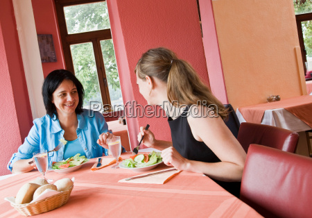 women talking over a meal