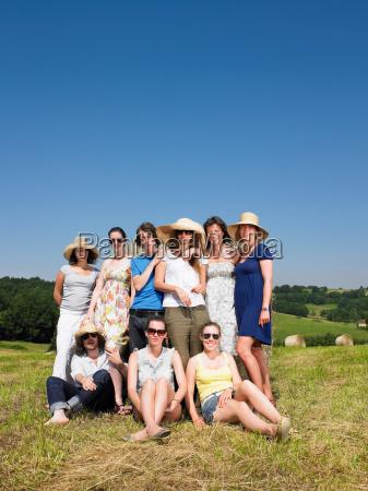 group of friends in field