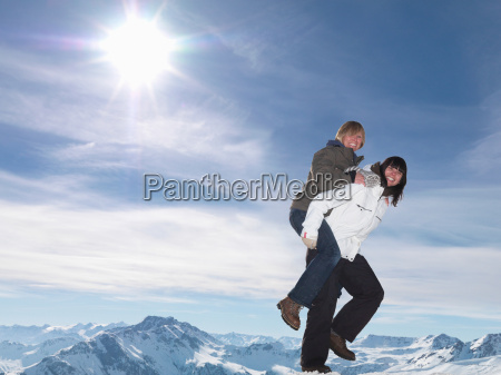 hikers playing piggyback ride
