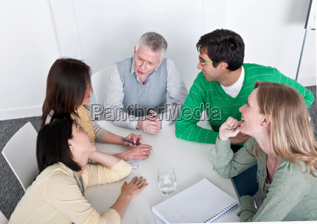 arm wrestling in group meeting