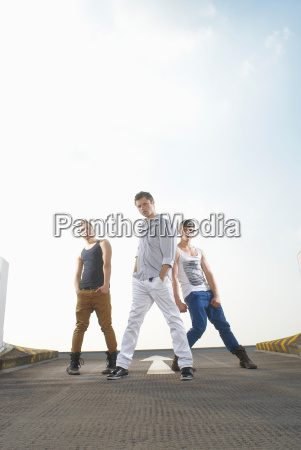 men dancing in road