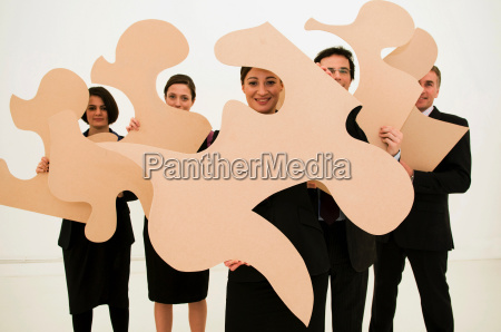 group, of, business, people, hold, jigsaw - 18439012