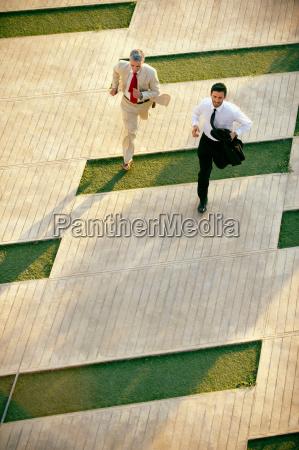 two business men running