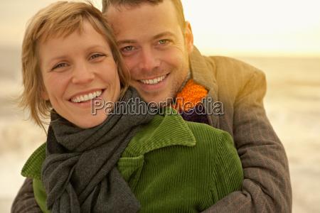 couple embracing on a beach autumn