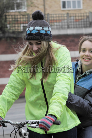 2 young women on 1 push