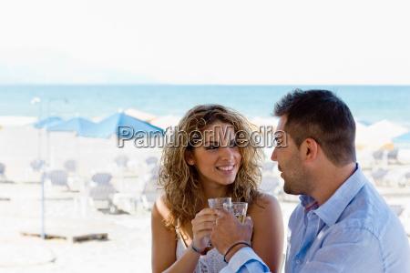 couple toasting near the beach