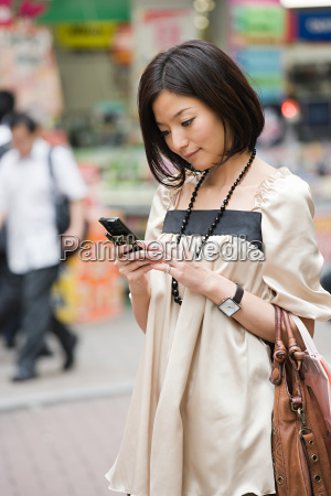 a woman using her cell phone