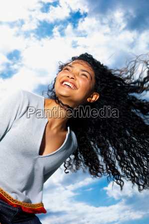 woman with cloudy sky