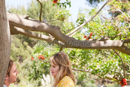 young couple by a tree
