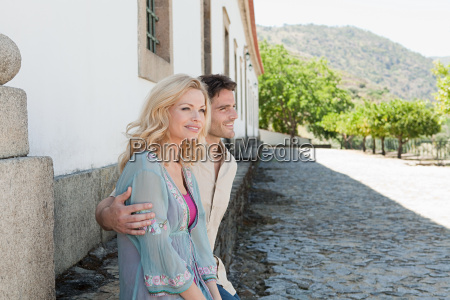 couple sitting by a building
