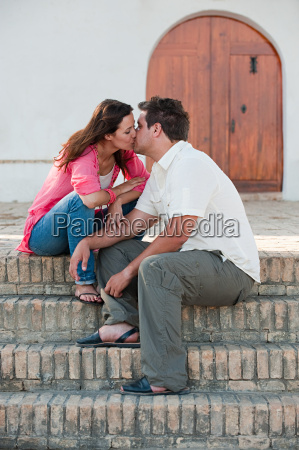 young romantic couple kissing