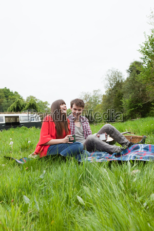 young couple on blanket in a