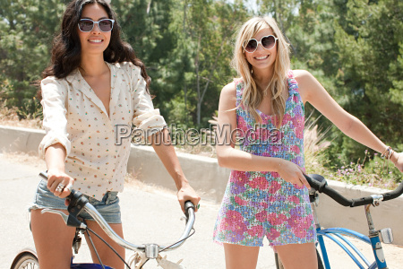 two young women with bicycles on