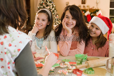 girls and mother making cookies