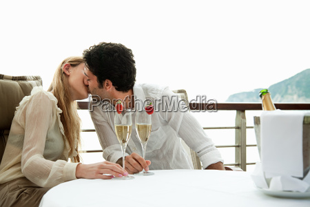 young couple kissing with champagne