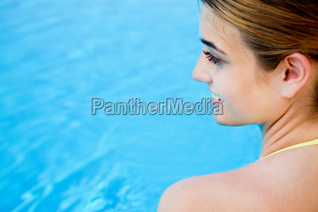 portrait of young woman by swimming