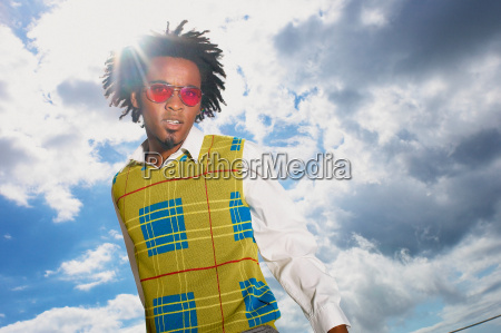 man with cloudy sky
