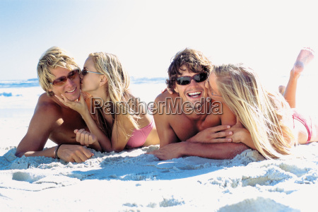 romantic women and men on beach