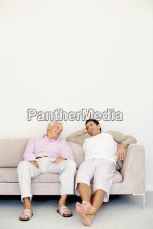 men talking on sofa