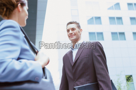 businessman, and, businesswoman, talking, outside, office - 18730928